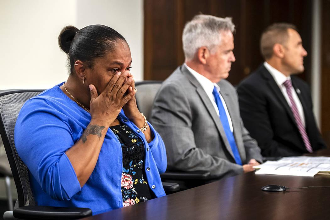 Taji Walsh, Nalani Johnson's grandmother, left, wipes away tears as Coleman McDonough, county p ...