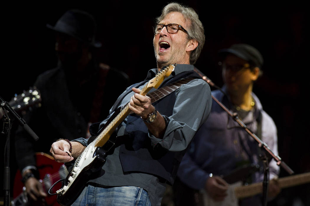 FILE - This April 14, 2013 file photo shows Eric Clapton performing at Eric Clapton's Crossroad ...