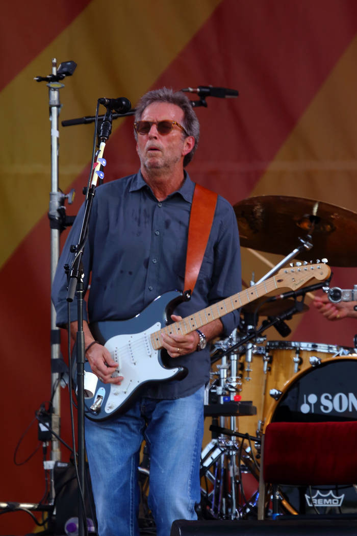 Eric Clapton performs at the 2014 New Orleans Jazz & Heritage Festival at Fair Grounds Race ...