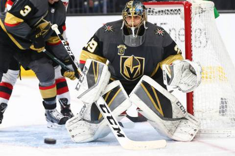 Golden Knights goaltender Marc-Andre Fleury (29) defends the goal while playing the New Jersey ...