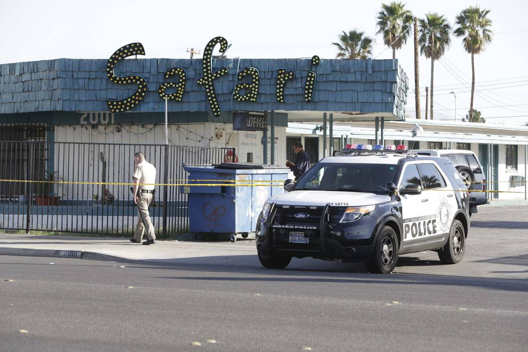 Las Vegas police investigate a fatal shooting at the Safari Motel, 2001 Fremont St., April 20, ...