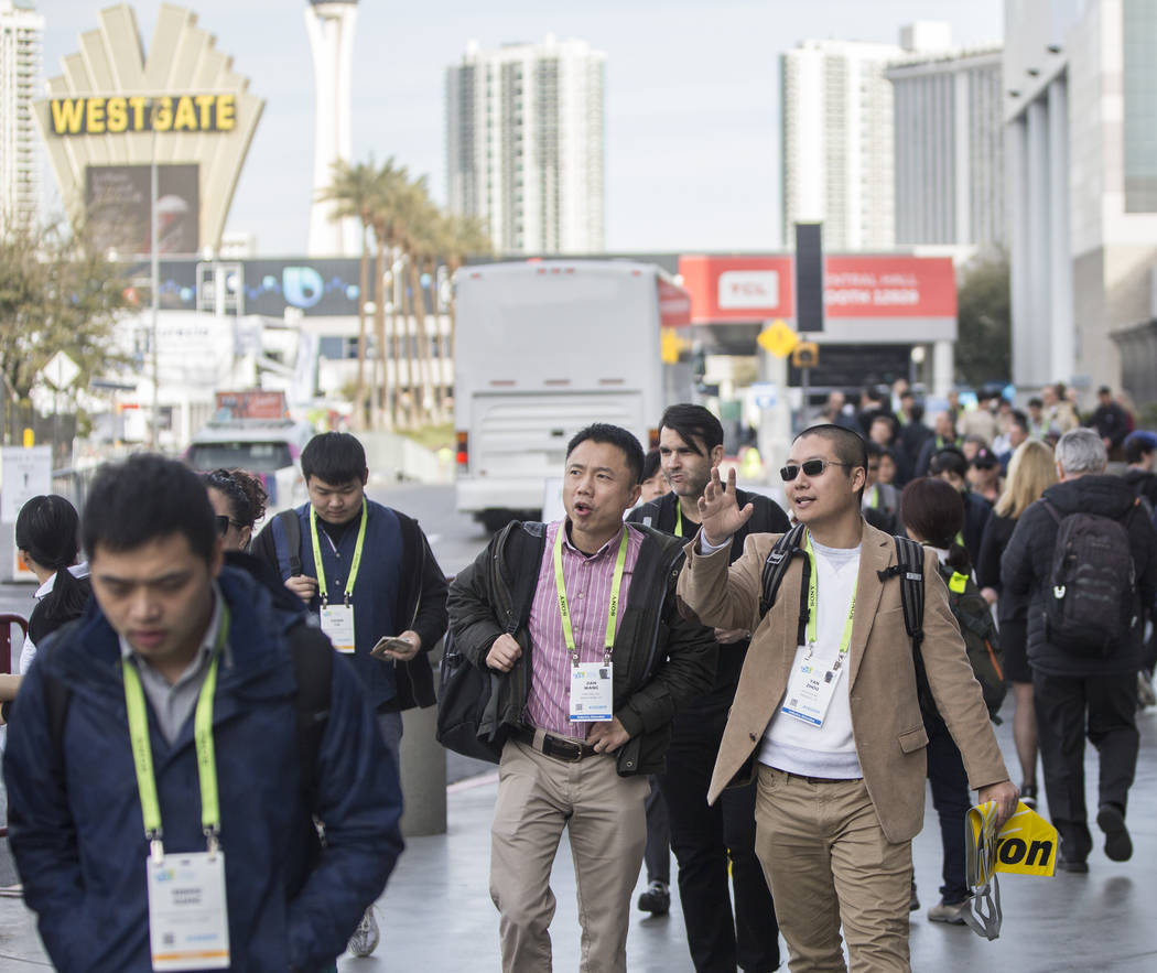 The sidewalks outside the Las Vegas Convention Center are packed during the last day of CES 201 ...