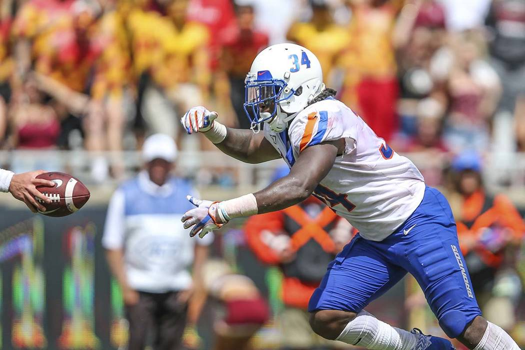Boise State running back Robert Mahone (34) takes a hand-off for what will be the game-winning ...