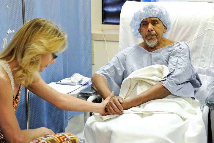 Susan Cervantes, left, comforts husband Agustin Cervantes before he undergoes hernia surgery by ...