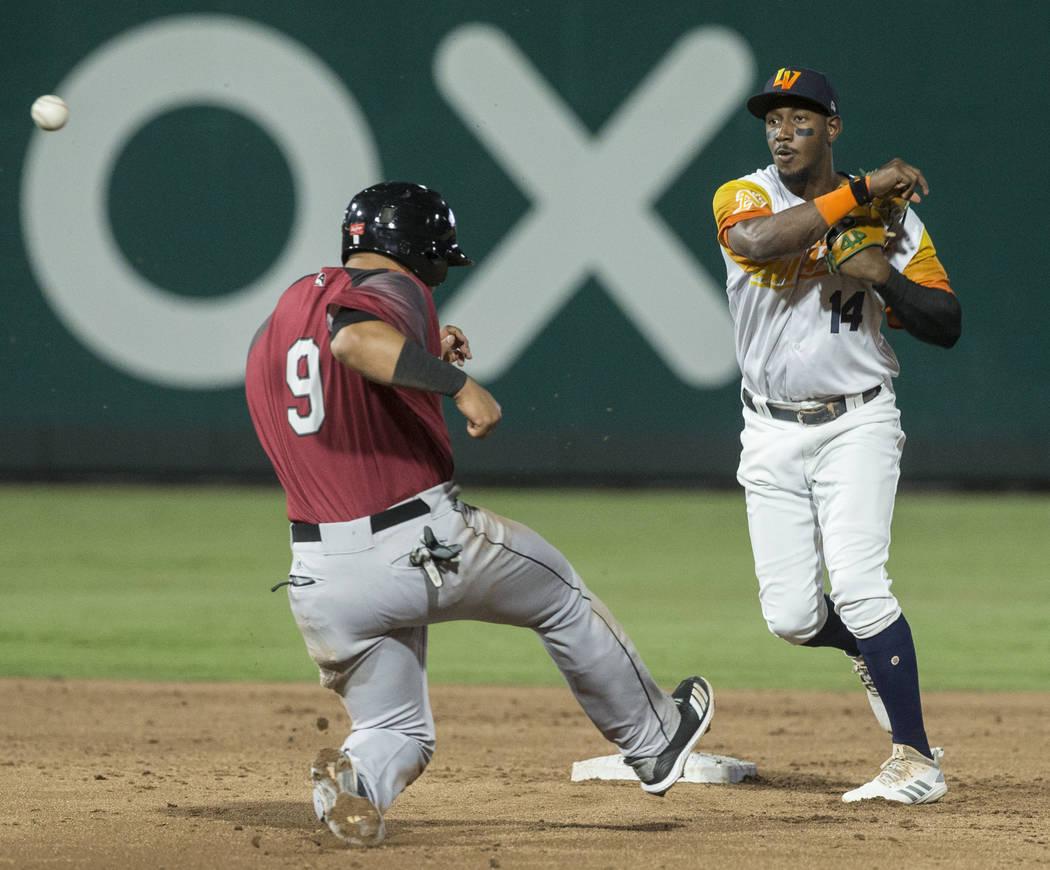 Las Vegas Aviators shortstop Jorge Mateo (14) turns a double play past Sacramento River Cats sh ...