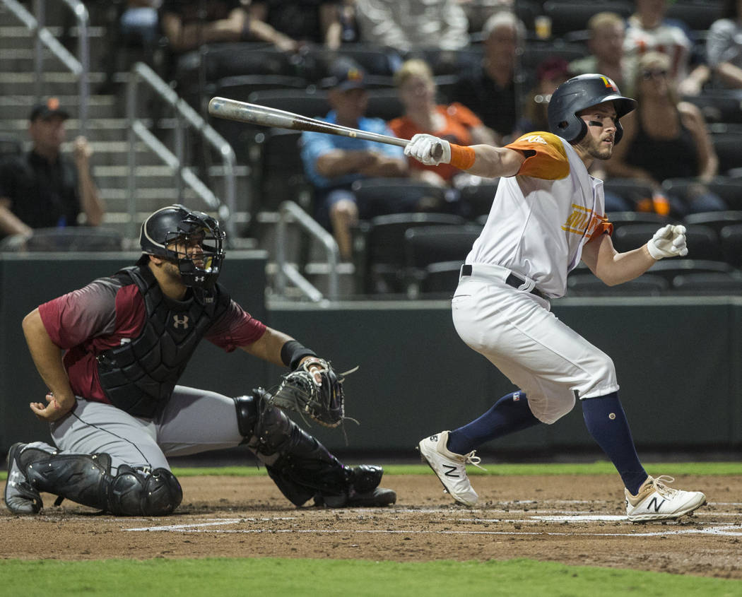 Las Vegas Aviators left fielder Mark Payton (16) doubles in a run in the bottom of the first in ...
