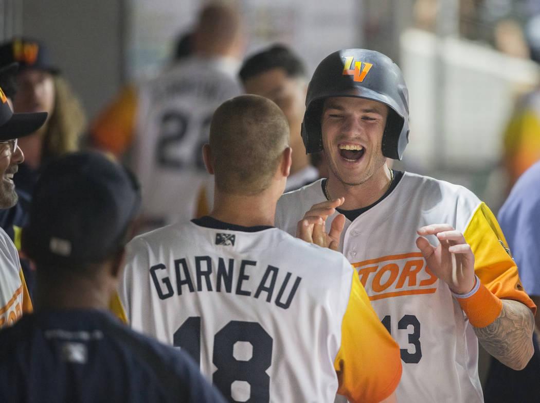 Las Vegas Aviators catcher Jonah Heim (13) celebrates with teammate Las Vegas Aviators catcher ...