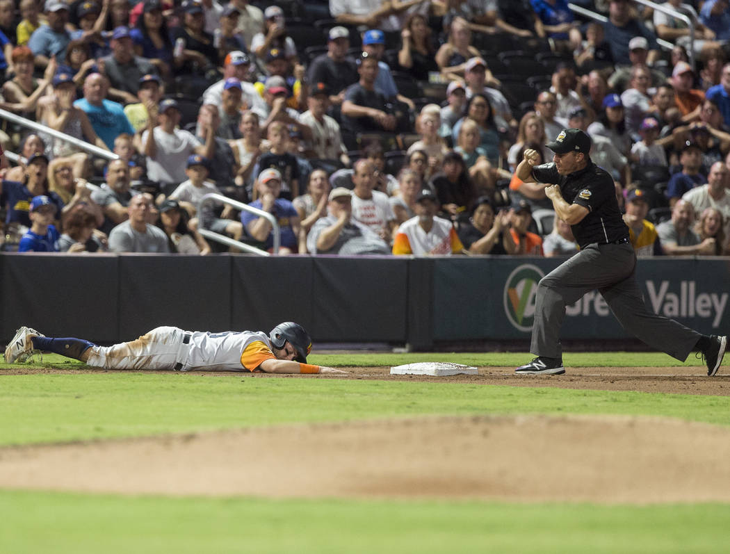 Las Vegas Aviators left fielder Mark Payton (16) is called out at third base in the bottom of t ...