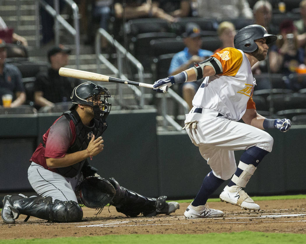 Las Vegas Aviators center fielder Dustin Fowler (10) singles in the bottom of the first inning ...