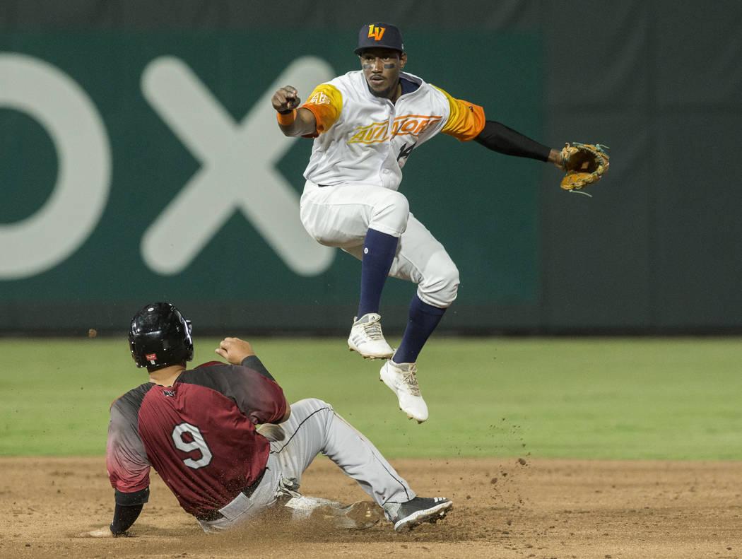 Las Vegas Aviators shortstop Jorge Mateo (14) leaps over Sacramento River Cats shortstop Crist ...