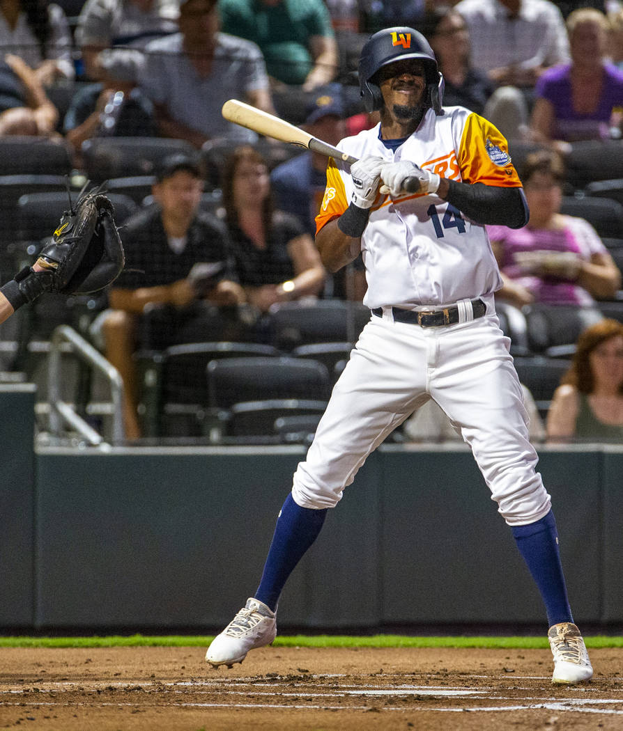 Las Vegas Aviators shortstop Jorge Mateo (14) is hit in the hand by a pitch by the Sacramento R ...