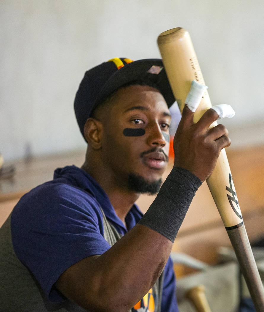 Las Vegas Aviators shortstop Jorge Mateo (14) attempts to grip a bat with fingers wrapped after ...