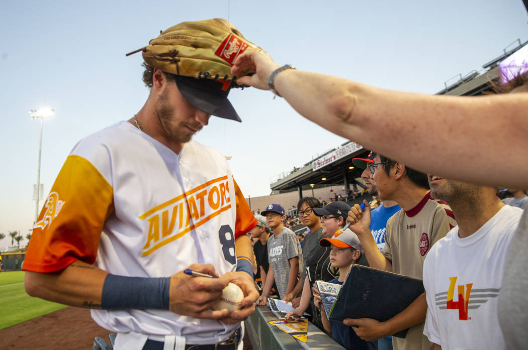 Las Vegas Aviators right fielder Skye Bolt (8) signs autographs with his glove on his head befo ...