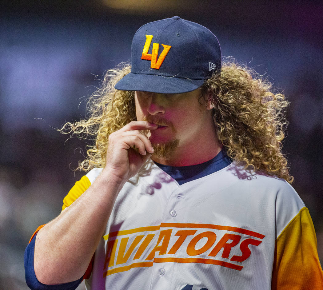 Las Vegas Aviators pitcher Grant Holmes (11) bites a nail on his way to the dugout versus the S ...