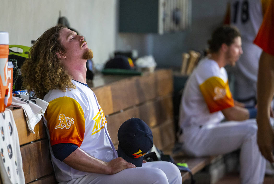 Las Vegas Aviators pitcher Grant Holmes (11) closes his eyes in the dugout versus the Sacrament ...