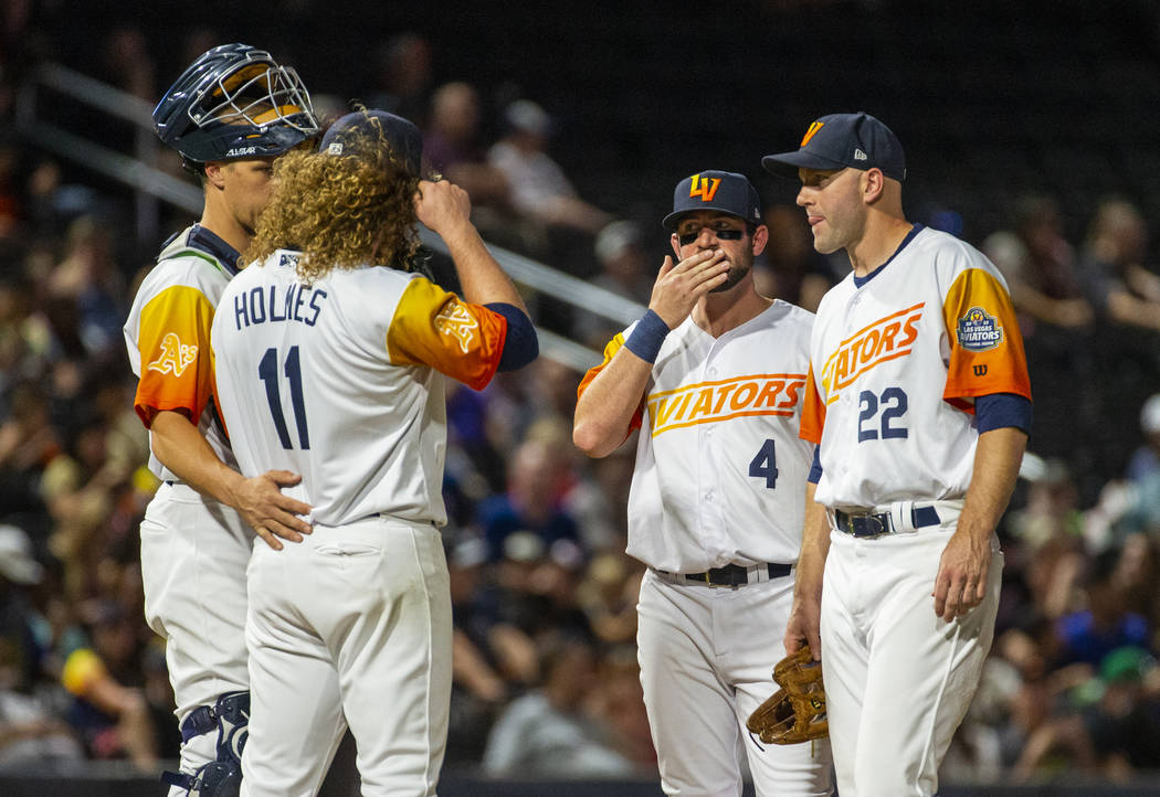 Las Vegas Aviators pitcher Grant Holmes (11) is consoled by teammates on the mound versus the S ...