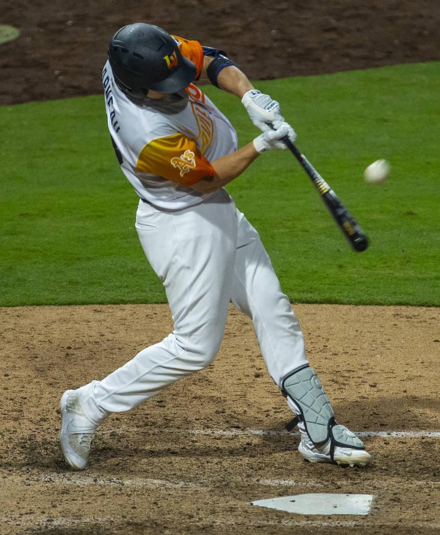 Las Vegas Aviators catcher Dustin Garneau (18) hits a long ball off the wall versus the Sacrame ...