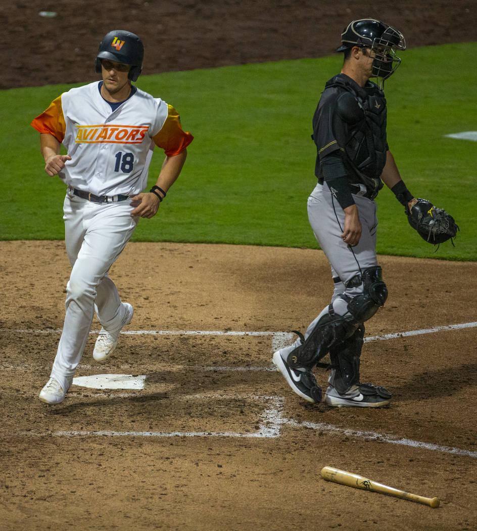 Las Vegas Aviators catcher Dustin Garneau (18) scores late versus the Sacramento River Cats dur ...