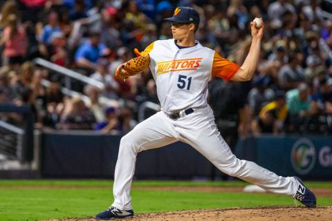 Las Vegas Aviators pitcher Kyle Lobstein (51) tosses a ball over the plate versus the Sacrament ...