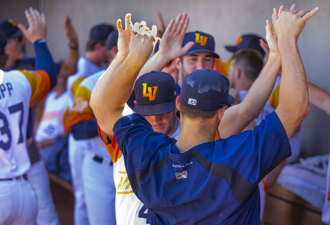 Las Vegas Aviators players get pumped up as they face the Sacramento River Cats during game fi ...