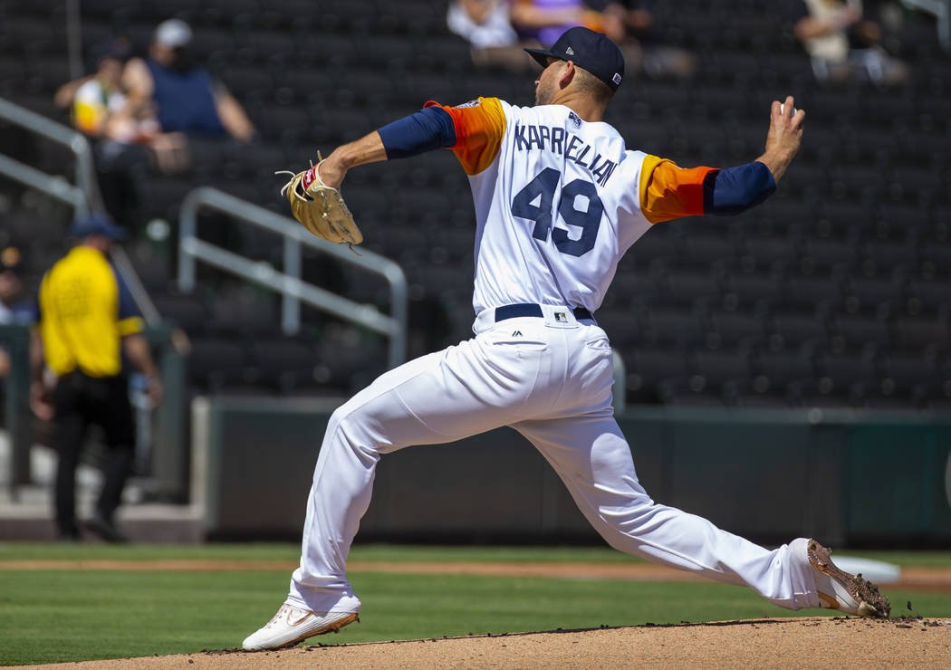 Las Vegas Aviators pitcher James Kaprielian (49) winds up on the mound in the first inning vers ...