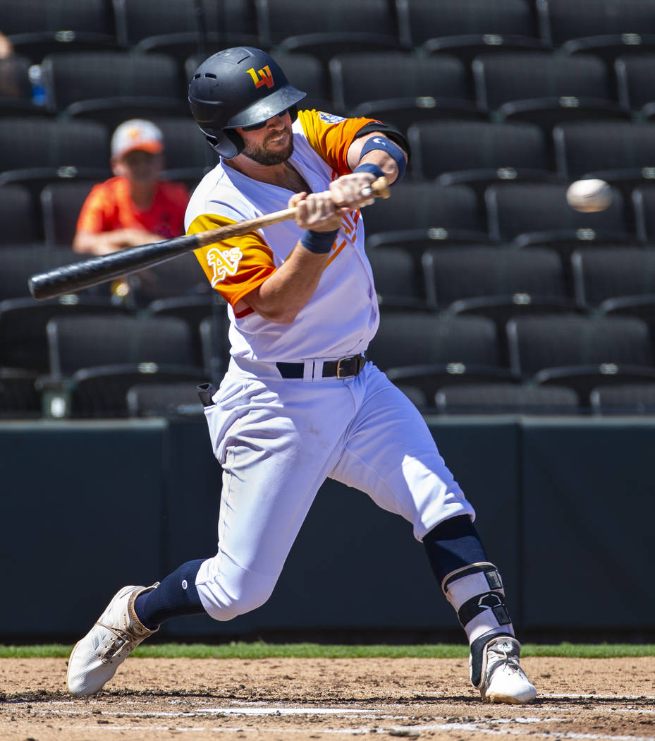 Las Vegas Aviators third baseman Mikey White (4) eyes a pitch at the plate in the first inning ...
