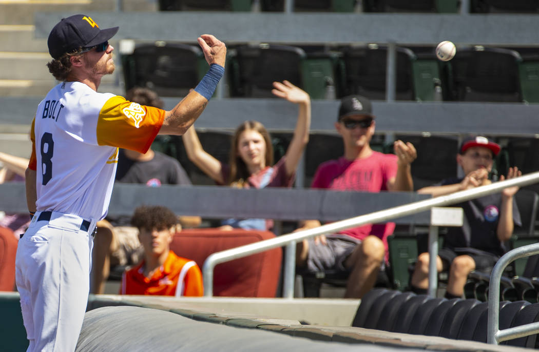 Las Vegas Aviators right fielder Skye Bolt (8) tosses a foul ball to a fan in the fourth inning ...