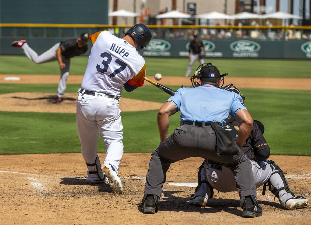 Las Vegas Aviators catcher Cameron Rupp (37) swings on another pitch by the Sacramento River Ca ...