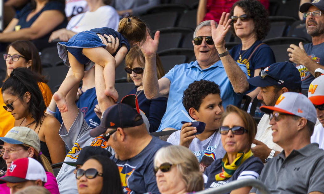 Las Vegas Aviators have fun and stay cool in the shade in the sixth inning as the team battles ...