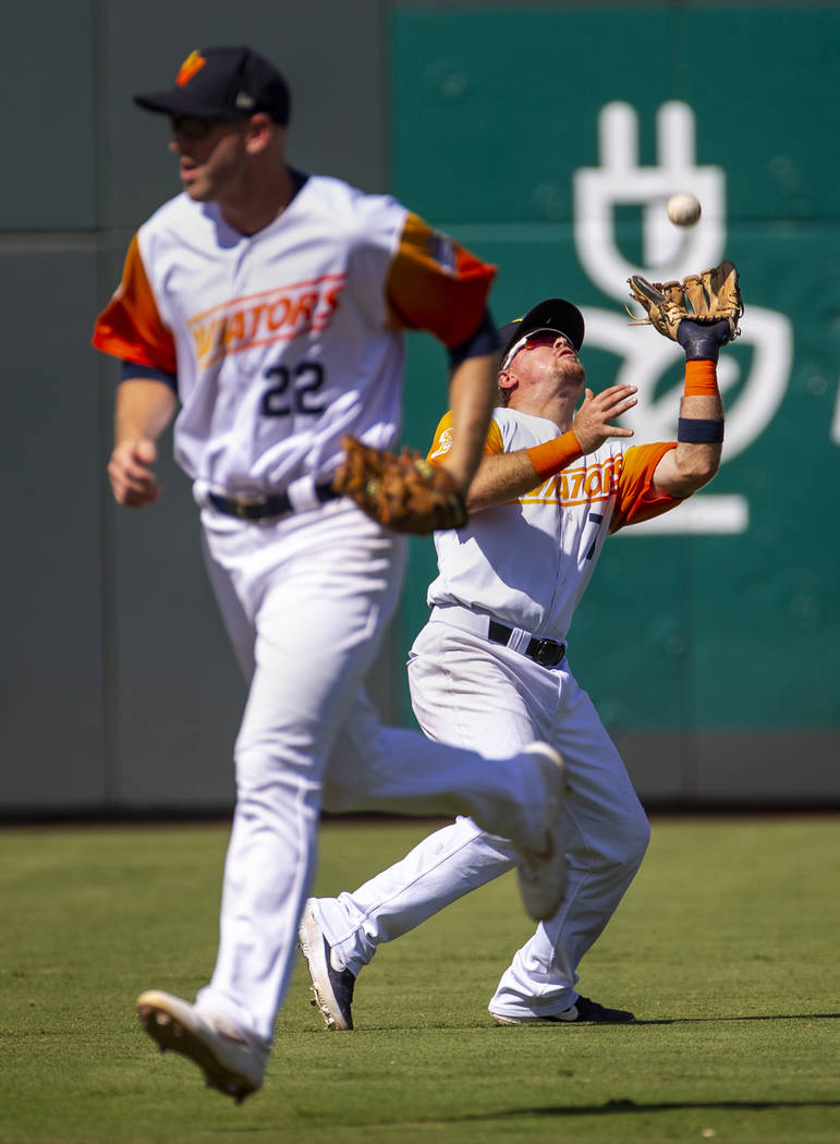 Las Vegas Aviators second baseman Trace Loehr (7, right) looks in a fly ball in the 8th inning ...