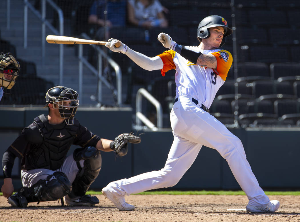 Las Vegas Aviators catcher Jonah Heim (13) misses the ball while batting in the ninth inning ve ...