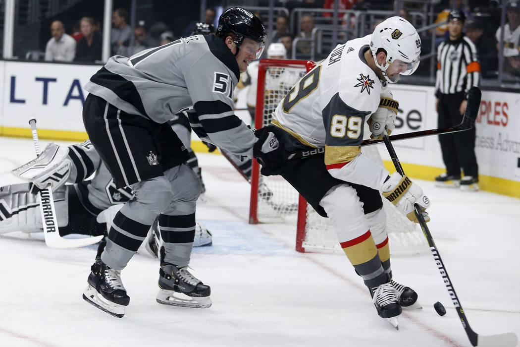 Los Angeles Kings goalie Jonathan Quick (32) blocks a shot by Vegas Golden Knights defenseman J ...