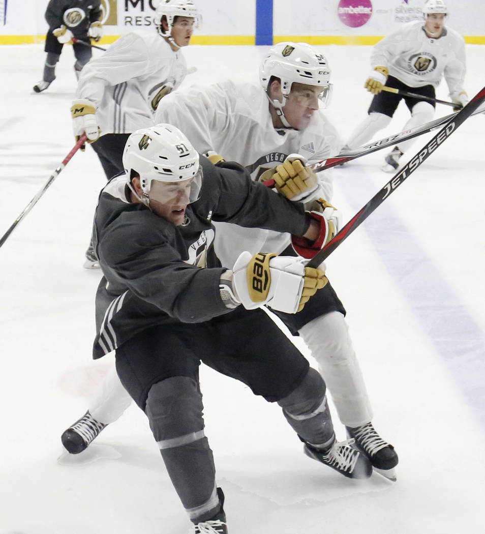 Vegas Golden Knights prospects Ben Jones, left, and Jimmy Schuldt collide during scrimmage at G ...