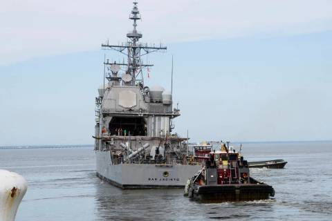 This image provided by the US Navy shows the USS San Jacinto (CG-56) as it heads out of the it' ...