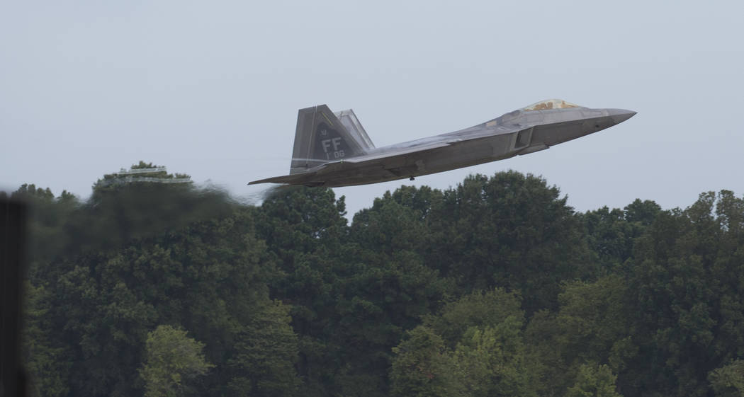 An F-22 Raptor jet clears the runway after takeoff at Langley Air Force Base on Wednesday, Sept ...