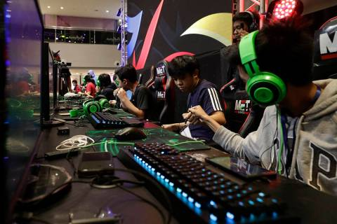 In this Thursday, Aug. 29, 2019, photo, esport (electronic sport) players react after winning t ...