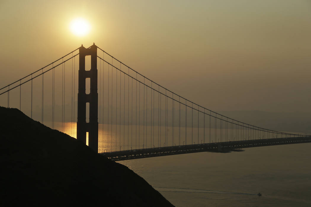Smoke from wildfires obscures the San Francisco skyline behind the Golden Gate Bridge Friday, N ...