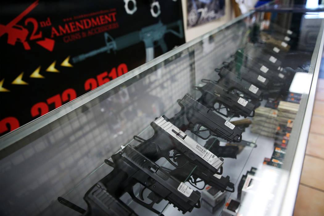 Guns are showcased at 2nd Amendment Gun Shop in Las Vegas, Wednesday, Sept. 4, 2019. (Erik Verd ...