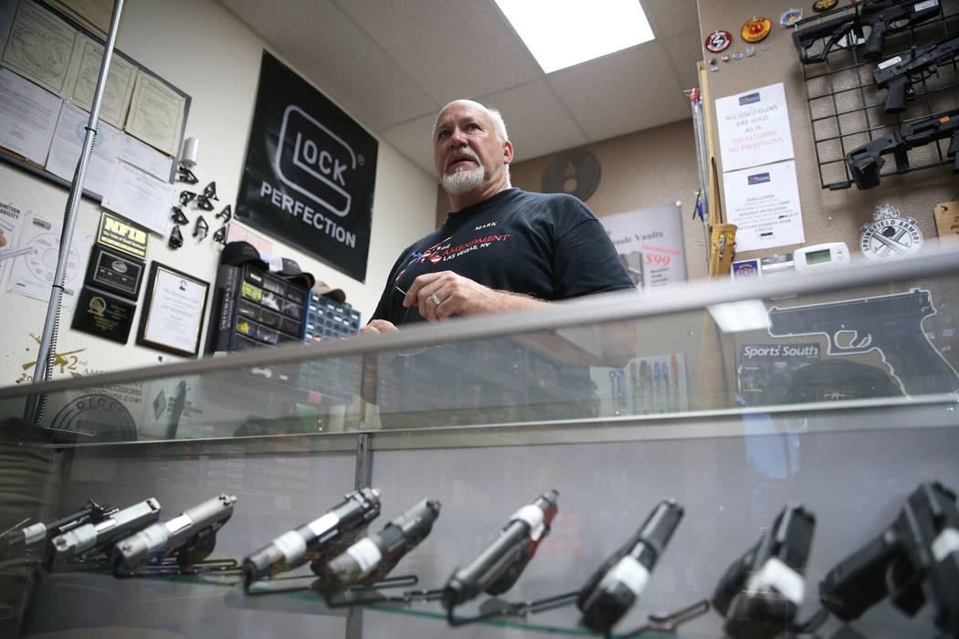 Mark Hames, owner of 2nd Amendment Gun Shop, is interviewed in his Las Vegas store, Wednesday, ...