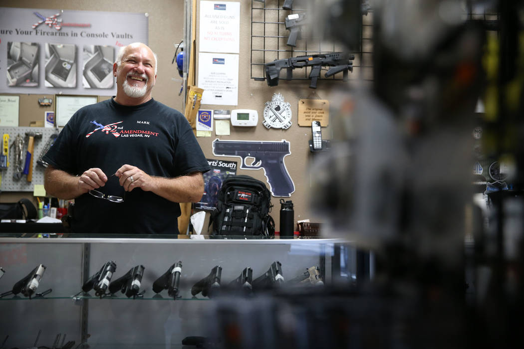 Mark Hames, owner of 2nd Amendment Gun Shop, is interviewed in his Las Vegas store, Wednesday, ...