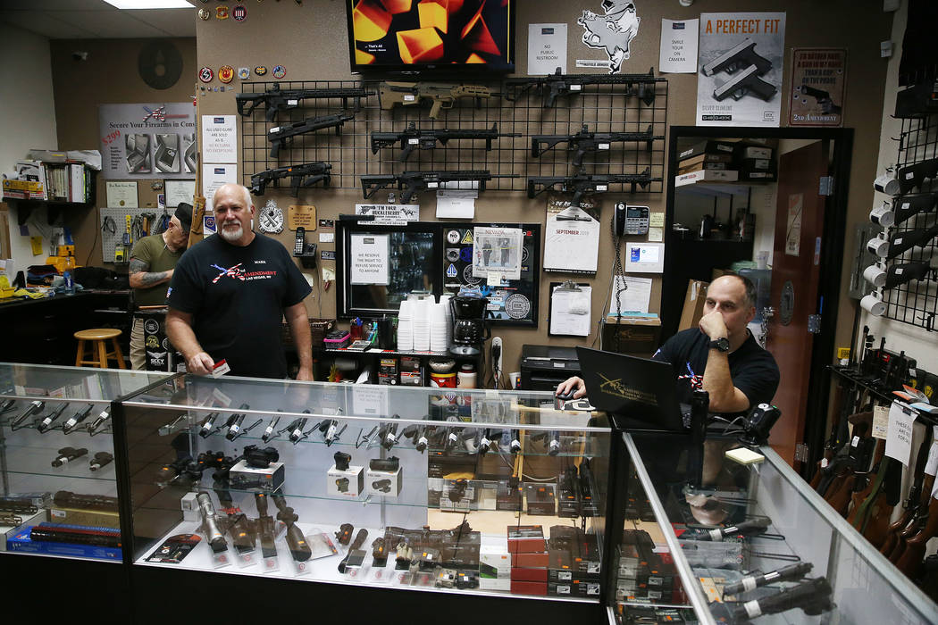 Mark Hames, owner of 2nd Amendment Gun Shop, and store manager Charles Mazza, are interviewed i ...