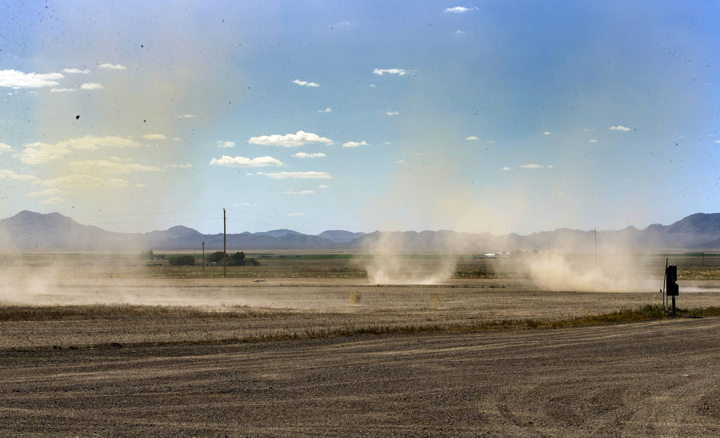 Dust devils kick up at the newly leveled site beside the Little A'Le'Inn which is to be the per ...