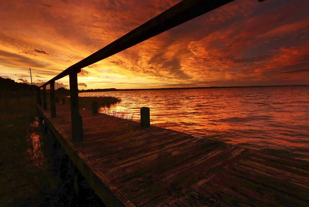 The sun sets over Lake Eustis in Tavares, Fla., on Wednesday, Sept. 4, 2019. By Wednesday, Hurr ...