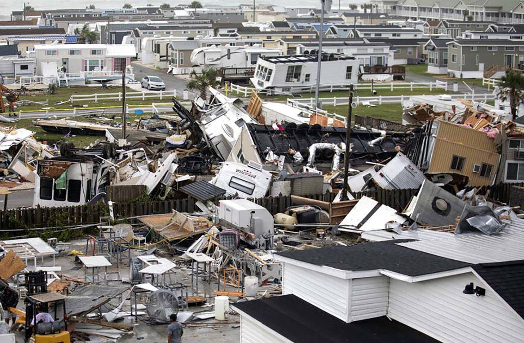 Mobile homes are upended and debris is strewn about at the Holiday Trav-l Park, Thursday, Sept. ...
