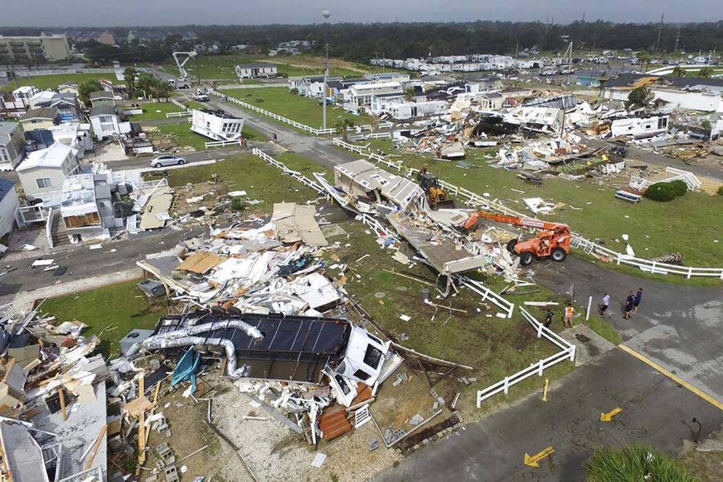 CORRECTS YEAR TO 2019-Emerald Isle town employees work to clear the road after a tornado hit Em ...