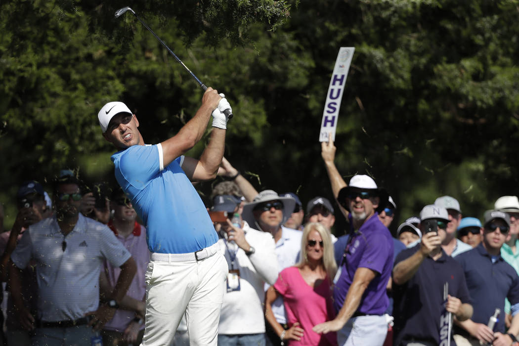 Brooks Koepka kits off the 16th tee during the final round of the World Golf Championships-FedE ...