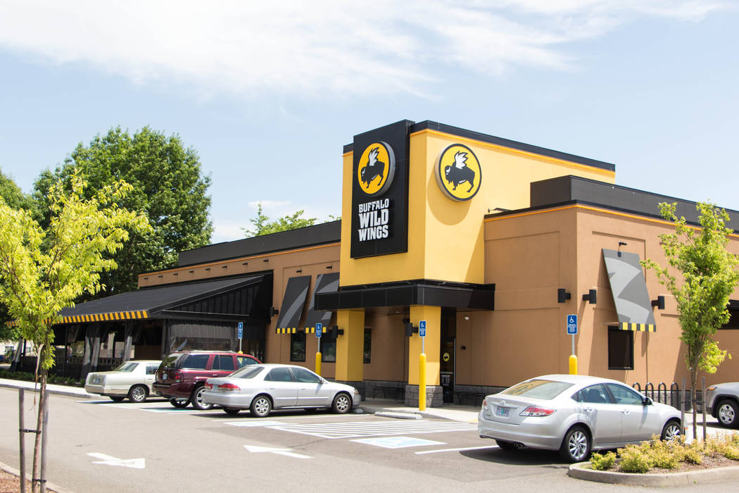 Buffalo Wild Wings is getting into a multiyear sports betting partnership with MGM Resorts Inte ...
