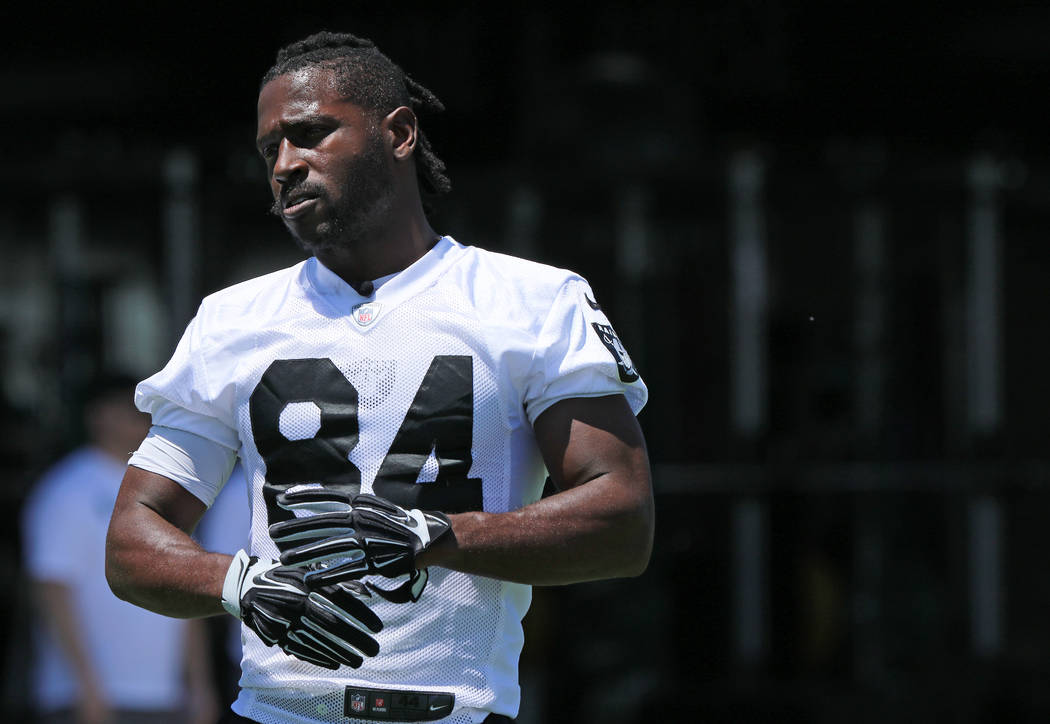 Oakland Raiders wide receiver Antonio Brown (84) stretches on the sideline during mandatory min ...
