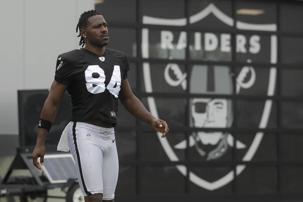 Oakland Raiders' Antonio Brown walks on the field while stretching during NFL football practice ...