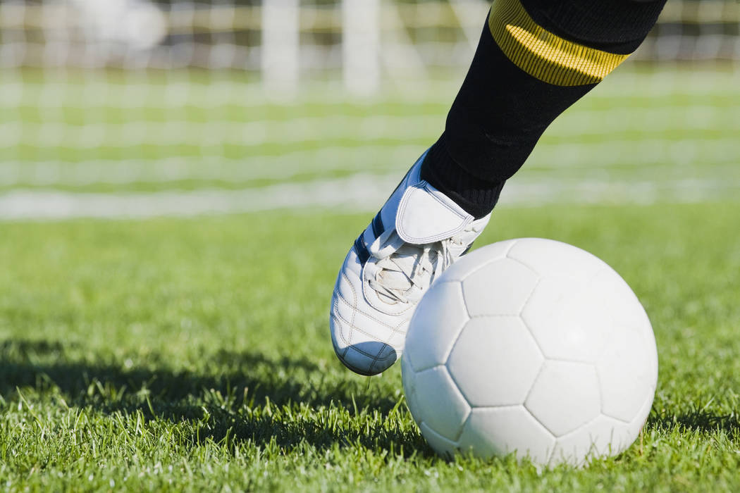 A soccer player kicking a soccer ball (Thinkstock)